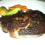 28 Ounce Blackend Prime Rib with potato, Bok Choy and carrots.