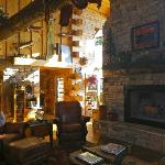 Their massive fireplace centers the lodge's main room full of interesting decor.
