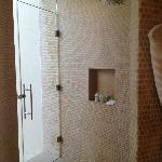 Shower and exit to outdoor shower in LAGOON VIEW SUITE
