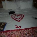Beautifully made bed after we had been laying on it!