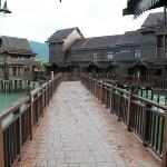 The walk way to rooms in Sea Village. U c fishes playing in water