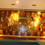 several paintings of great golfers in reception rooms