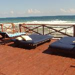 view of deck by pool and beach