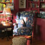 A cozy chair in a sunny corner of the living room