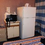 a full size kitchen fridge at the foot of the bed. normally you would expect a mini fridge. i st