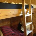 Bunk beds. Bottom bunk is made with the sheets and blanket provided. Top bunk not yet made up.