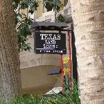 River Walk sign for Texas Land and Cattle Steakhouse.
