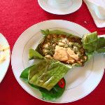 chicken with lemon leaf cooked in banana leaf