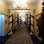 Hallway to central lobby decorated for holidays