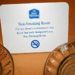 "The ash trays and matches beside the ""no smoking"" sign"