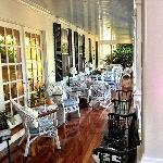 Beautiful porch beckons to come sit awhile!