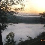 Sunrise taken through camper window...fog over WI River