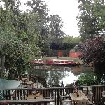 Outdoor back porch scenery of a river houseboat docked along the walkway