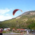 Paraglider landing outside the hotel