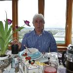 Monika's pic of me at Breakfast with Christchurch background.