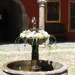 Little fountain in the center of the courtyard