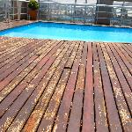 the broken wooden planks at the pool area.
