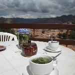 deck and view of cusco with coca leaf tea