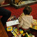 Our daughter enjoying her toys provided