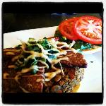 Pumpkin and green lentil burger topped with garlic aioli