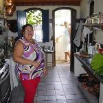 Dona Flor in the kitchen with two of the cooks.