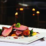 Duck Breast, caramelized figs, duck confit, beet greens, duck demi-glace