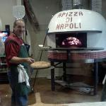 Owner Cliff in front of imported fire brick oven from Italy
