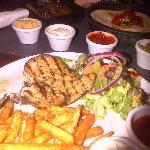 Cajun chicken, salad, salsa, sour cream, spiced fries: £12.95 In background, Sizzling steak f