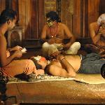 Kathakali performers preparing their make up