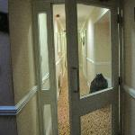 Privacy door between stairway and guestroom corridor