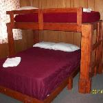 One of two bunk beds in this semi-private room