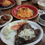 palomilla steak, yellow rice, black beans, and fried plantains.