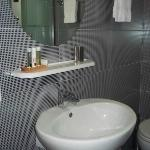 Bathroom with sink and toiletries