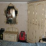 Armoire and chest with linens