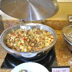 Buffet of potatoes with ground pork