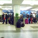 Waiting in line for check-in to the left desk.