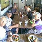 Hiking group having lunch outside at Local Restaurant