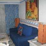 Same blue couch, new orange lamps, new orange accents, in updated suite