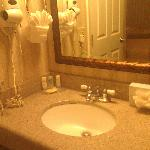 Cute vanity mirror and sink.