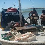 Llegada de los pescadores con la pesca del día