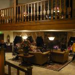 Downstairs lobby, seating near fireplace and piano