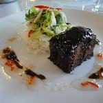 Braised beef belly with a Thai BBQ marinade, coconut steamed rice, lime and pickled cucumber sal