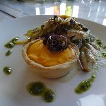 Fish, pernod and carrot tartlet, preserved lemon and caper buerre noisette and sauté leek