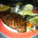 21 oz steak with mushroom and chimichurri sauces, sides.  $49