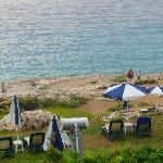 sun loungers on cliff side and grass areas