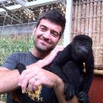hubby holding mid-size howler monkey