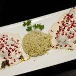 Delicious! Stuffed Peppers with a White Cream sauce and Pomegranite seeds!