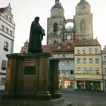 In Luther's day there were no buildings isolating the church from the market square