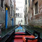 Take a gondola ride thru small canals