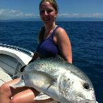 A big Trevally for this happy girl